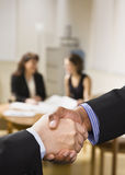 People Shaking Hands in Office Stock Photography