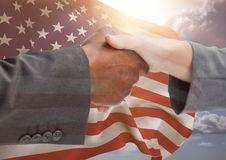 People shaking their hands against american flag. Digital composite of people shaking their hands against american flag Stock Photos