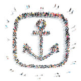 People in the shape of an anchor. Royalty Free Stock Photography