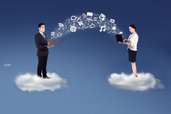 People sharing information on cloud Stock Photo