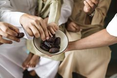 People sharing some dried dates Royalty Free Stock Photos