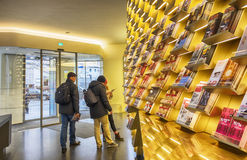 People and shelves with information in tourist office in Vienna, Austria, 21 December 2015 Royalty Free Stock Photography