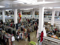People shop for clothes inside a thrift store Royalty Free Stock Image