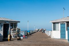 People Shop and Fish on Top of Historic Crystal Pier. SAN DIEGO, CALIFORNIA - APRIL 21, 2017:  People shop and fish on top of the historic Crystal Pier, a Stock Image