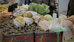 People in the shop. Fruits vegetables potato pumpkin sprouts Lemons stock footage