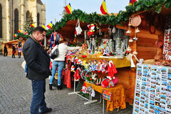 People shop gifts for Christmas at market stalls Royalty Free Stock Photo