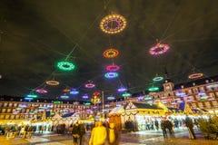 people shop at illuminated christmas market Stock Photos