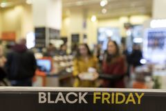 People shop inside a department store during Black Friday shoppi. Thessaloniki, Greece - November 24, 2017. People shop inside a department store during Black Royalty Free Stock Images