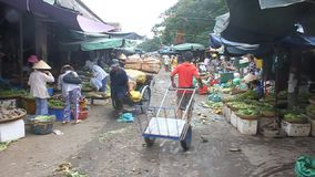 People shop at a market
