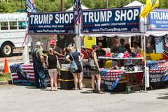 People Shop For Merchandise At Outdoor Donald Trump Popup Store. Helen, GA, USA - June 2, 2018:  People look over the merchandise at the Trump Shop, a popup royalty free stock images