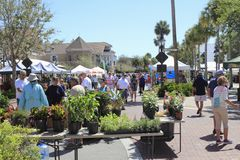 People Shop at an Outdoor Street Market. The Villages, FL, USA -April 1, 2017: People shop at an outdoor street market. People shopping at farmers market on royalty free stock photos