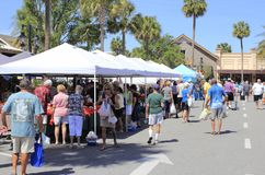 People Shop from Various Market Sellers. The Villages, FL, USA -April 1, 2017: People shop from various market sellers. People buy at Farmer's Market shops royalty free stock photo