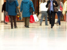 People Shopping. Inside a mall (Blurred motion demonstrates the motion and also protects people privacy stock photography