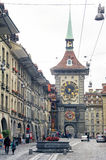 People on the shopping alley with the famous clocktower of Bern Stock Image