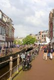 People are shopping along a canal in Leeuwarden, Friesland, Netherlands Royalty Free Stock Photos