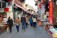 Shopping people and souvenir shops in the ancient Old Street, Tunxi, China. People are shopping in the ancient Old Street in the city center of Tunxi (Huangshan Stock Photo
