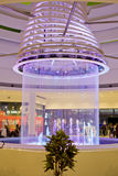 People shopping around the ceiling fountain Stock Photos
