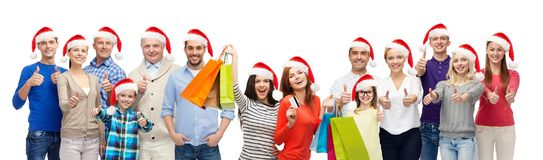 People with shopping bags at christmas sale Royalty Free Stock Photography