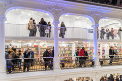 People Shopping For Books In Library. BUCHAREST, ROMANIA - FEBRUARY 12, 2015: People Crowd Rush On Shopping Literature Books In Library Stock Photos