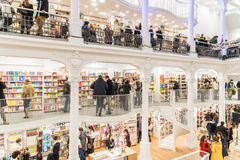 People Shopping For Books In Library. BUCHAREST, ROMANIA - FEBRUARY 12, 2015: People Shopping For Literature Books In Library Royalty Free Stock Images