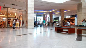 People shopping in busy mall stock video footage