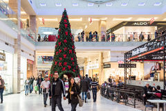 People Shopping For Christmas In Luxury Shopping Mall Royalty Free Stock Image