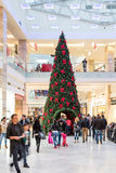 People Shopping For Christmas In Luxury Shopping Mall Royalty Free Stock Images