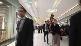 People shopping for Christmas presents in mall stock video footage