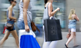 People shopping in the city. In motion blur Royalty Free Stock Photo