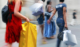 People shopping in the city. In motion blur Royalty Free Stock Photography