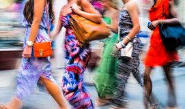 People shopping in the city. In motion blur Stock Images
