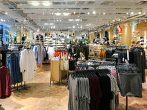 People Shopping For Clothes In Fashion Mall Shop. BUCHAREST, ROMANIA - SEPTEMBER 01, 2016: People Shopping For Clothes In Fashion Mall Shop Royalty Free Stock Image