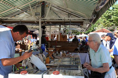 People shopping at the famous of antique market  Cours Saleya, N Royalty Free Stock Photography