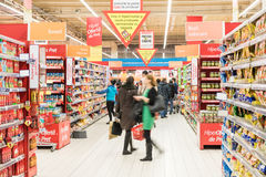 People Shopping For Food In Supermarket Store Aisle Stock Photo