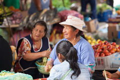 People shopping at Fresh Food market in Ecuador Stock Photo
