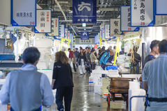People shopping in a fresh food market in Osaka, Japan Stock Photos