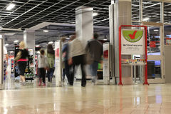 People shopping in future shop store with motion blur Stock Photography