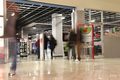 People shopping in future shop store with motion blur Royalty Free Stock Photography
