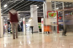 People shopping in future shop store with motion blur Royalty Free Stock Image