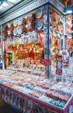 People shopping in Great Market Hall for souvenir. Hungarian Paprika, ceramic dish, handicraft embroidery, lace, egg. Royalty Free Stock Photography