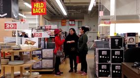 People shopping inside home outfitters store stock footage