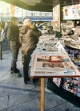 People shopping for international newspapers stock images