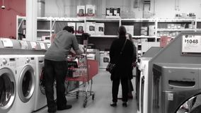 People shopping large appliance store stock video