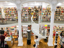 People Shopping For Latest Literature Fiction And Non-Fiction Books In Modern Library Stock Photography
