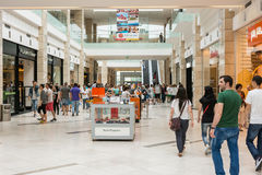 People Shopping In Luxurious Shopping Mall Stock Images