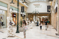 People Shopping In Luxurious Shopping Mall Stock Photo