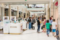 People Shopping In Luxurious Shopping Mall. BUCHAREST, ROMANIA - JUNE 14: People Shopping In Luxurious Shopping Mall on June 14, 2014 in Bucharest, Romania stock image