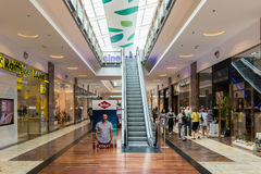 People Shopping In Luxurious Shopping Mall Royalty Free Stock Photos