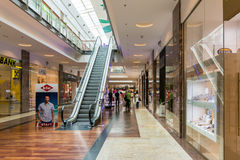 People Shopping In Luxurious Shopping Mall Stock Photos