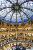People shopping in luxury Lafayette department store of Paris, France Royalty Free Stock Images